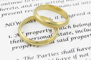 Two wedding rings on prenuptial agreement.